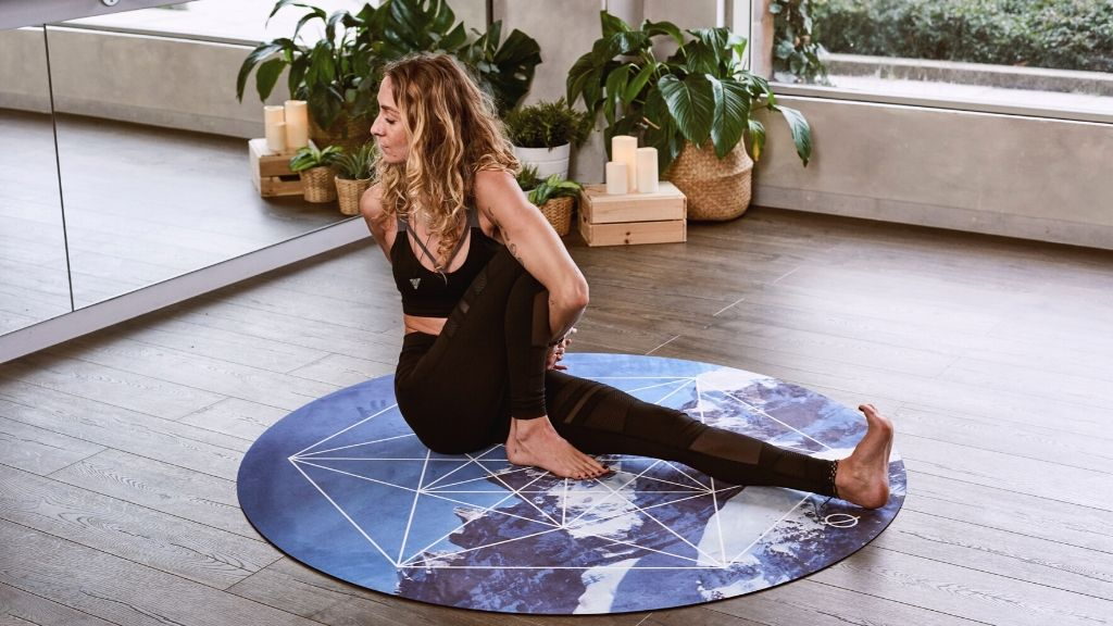 A woman practising yoga at home
