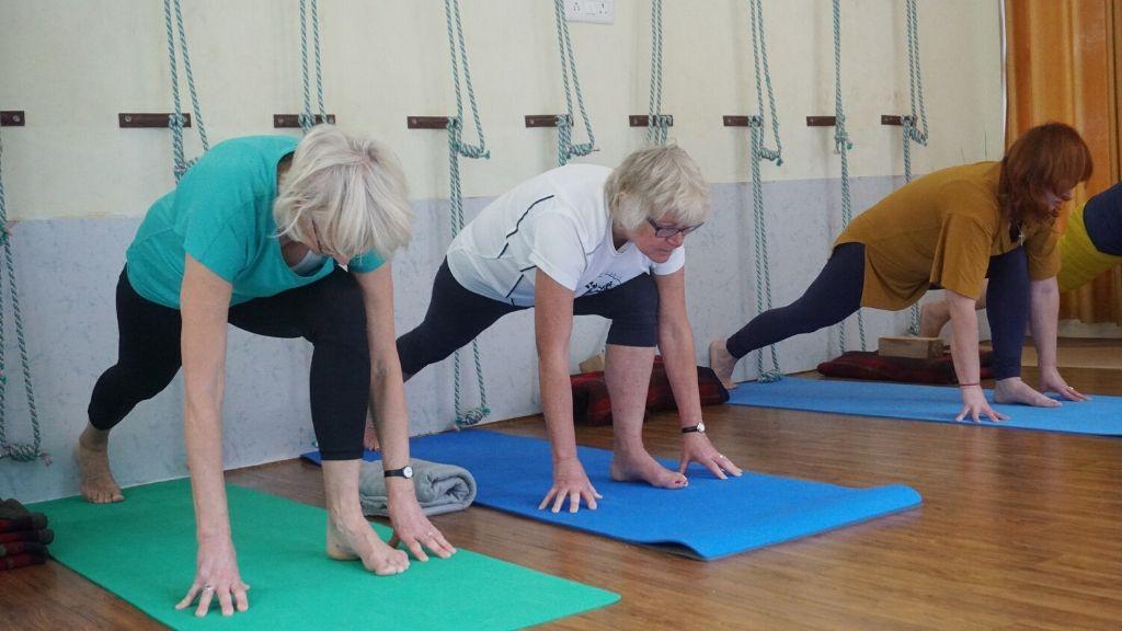 Elderly people practising yoga