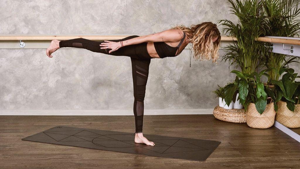 Woman practising yoga on a yoga mat