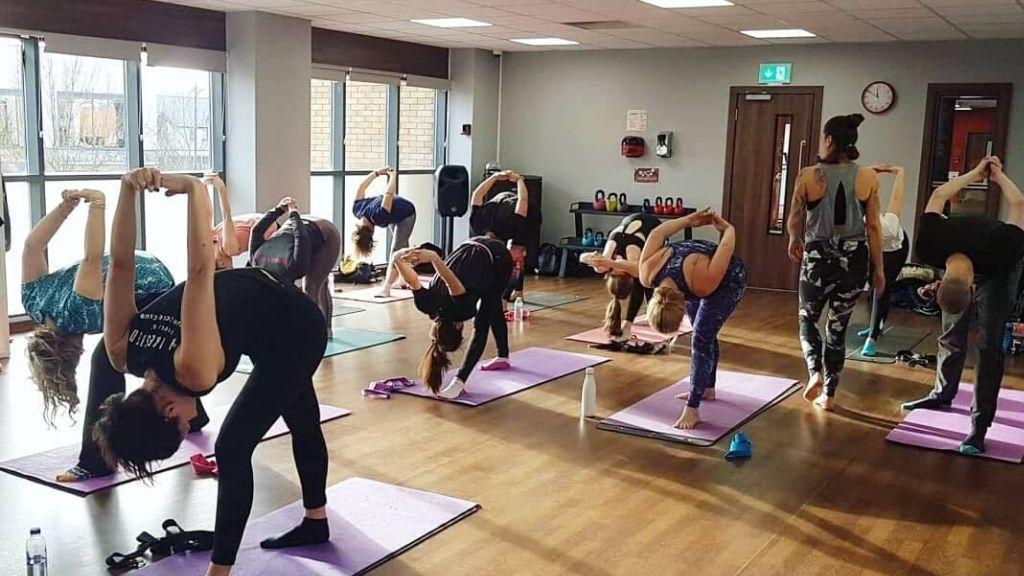 Yoga teacher and class